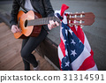 Artist with the US flag playing the guitar 31314591
