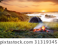 campfire and tent at sunrise 31319345
