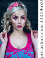 Beautiful blonde girl with creative doll make-up 31319630