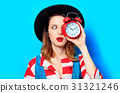 Woman with alarm clock 31321246