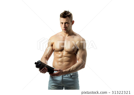 Muscular man with protein drink in shaker over 31322321
