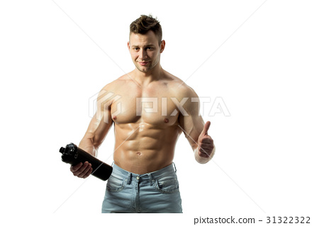 Muscular man with protein drink in shaker over 31322322