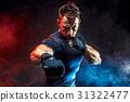 Studio portrait of fighting muscular man in smoke 31322477