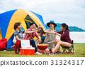 Group of man and woman enjoy camping picnic 31324317