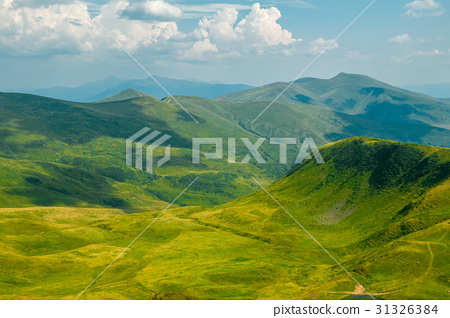 Shadows of Clouds over Summer Mountains 31326384