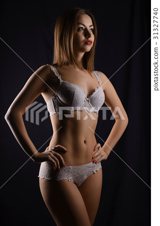 873408e300a Sexy woman with long hair in white lingerie - Stock Photo  31327740 ...