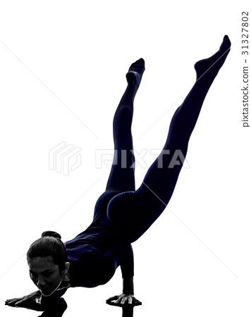 woman exercising Mayurasana peacock pose yoga 31327802