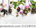 Tea spoons with tea leaves 31328554