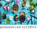 Tea spoons with tea leaves 31328555