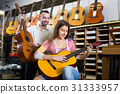 customers in music instruments shop 31333957