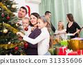Happy family with Christmas tree at home. 31335606