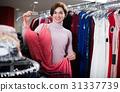 Woman choosing pretty dress 31337739