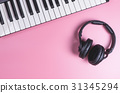 Music Studio Keyboard and Headphone on pink 31345294