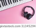 Music Studio Keyboard and Headphone on pink 31345294