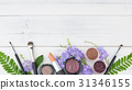 Purple flowers, green leaves, cosmetics  31346155