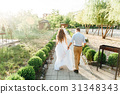 Just married couple walking in pine forest 31348343