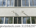 Two surveillance cameras on a house wall 31356297