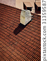 White chimney on a red tiled roof 31359587