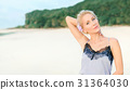 Beautiful white woman with short hair on a beach ( 31364030