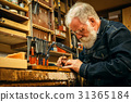 Senior wood carving professional during work 31365184