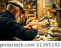 Senior wood carving professional during work 31365192