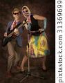 Rockabilly couple having fun 31369699