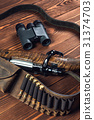 Hunting equipment with knife and binoculars on old 31374703