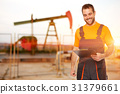 Refinery worker reads the data from the black plates 31379661