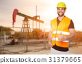 Refinery worker reads the data from the black plates 31379665