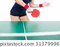Ping pong player hitting the ball 31379996