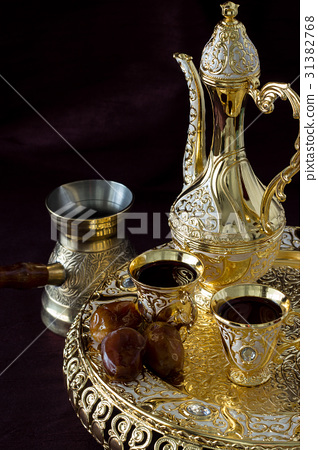 Traditional golden Arabic coffee set with dallah 31382768