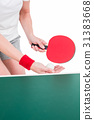 Female athlete playing ping pong 31383668
