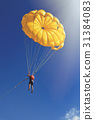 Skydiver on yellow parachute in sunny blue sky 31384083