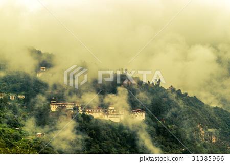 View of Trongsa Dzong with foggy hills, Bhutan 31385966