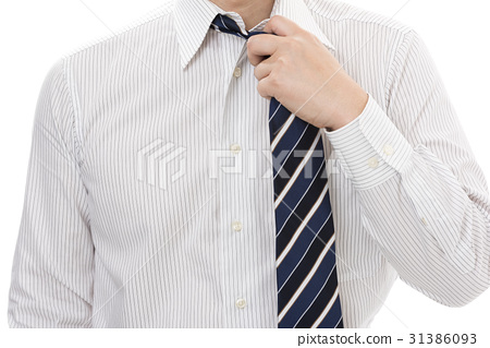 A businessman loosening a tie 31386093