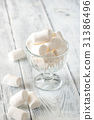 Glass bowl of marshmallows  31386496