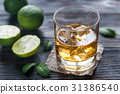 Glass of rum on the wooden background 31386540