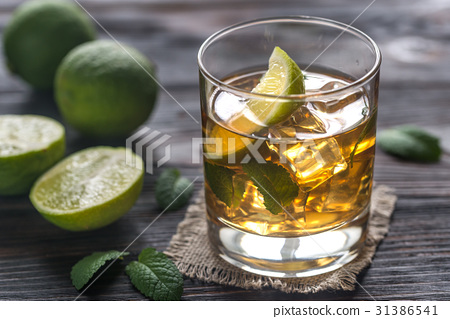 Glass of rum on the wooden background 31386541