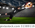 Soccer or football keeper catching ball 31389116