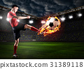 player is kicking ball 31389118