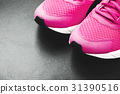 Pink sneakers on black background 31390516