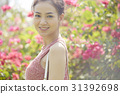Young woman with happy face in flower garden 31392698