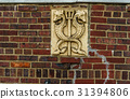 Bas-relief two seahorses on a old red brick wall 31394806