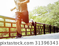 Man doing sports and jogging, running in a park. 31396343