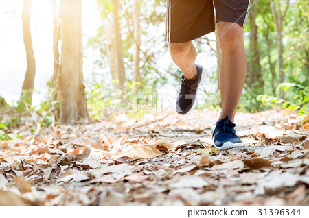 Trail running man exercising outdoors for fitness. 31396344