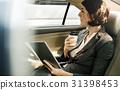 Businesswoman Using Tablet Car Inside 31398453