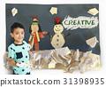 Children having fun with snowman artwork 31398935