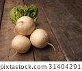 Three may turnip on wood 31404291