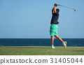 Golfer hitting ball with force 31405044