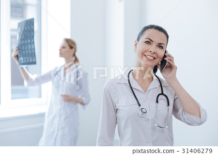 Sophisticated practitioner using modern gadget at 31406279